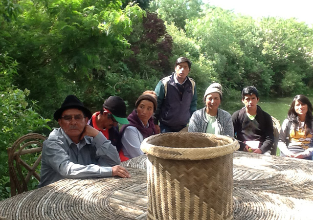 Teaching with traditional farmers at our wooden deck.